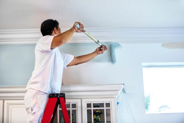 iStock-000029226014_Man-painting-wall-with-roller.jpg.rend_.hgtvcom.616.411